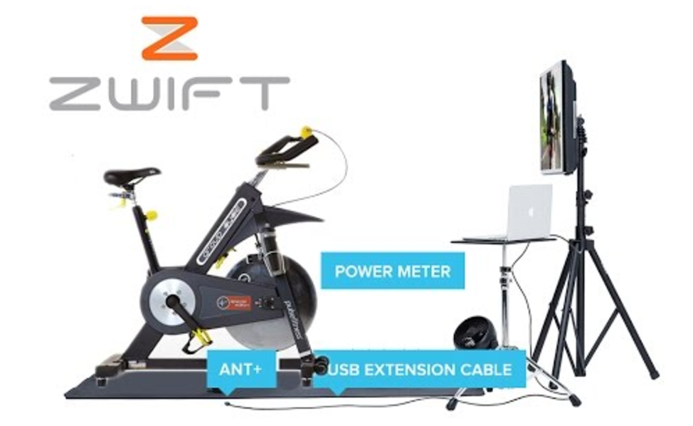 Stationary bike in front of TV and computer for Zwift